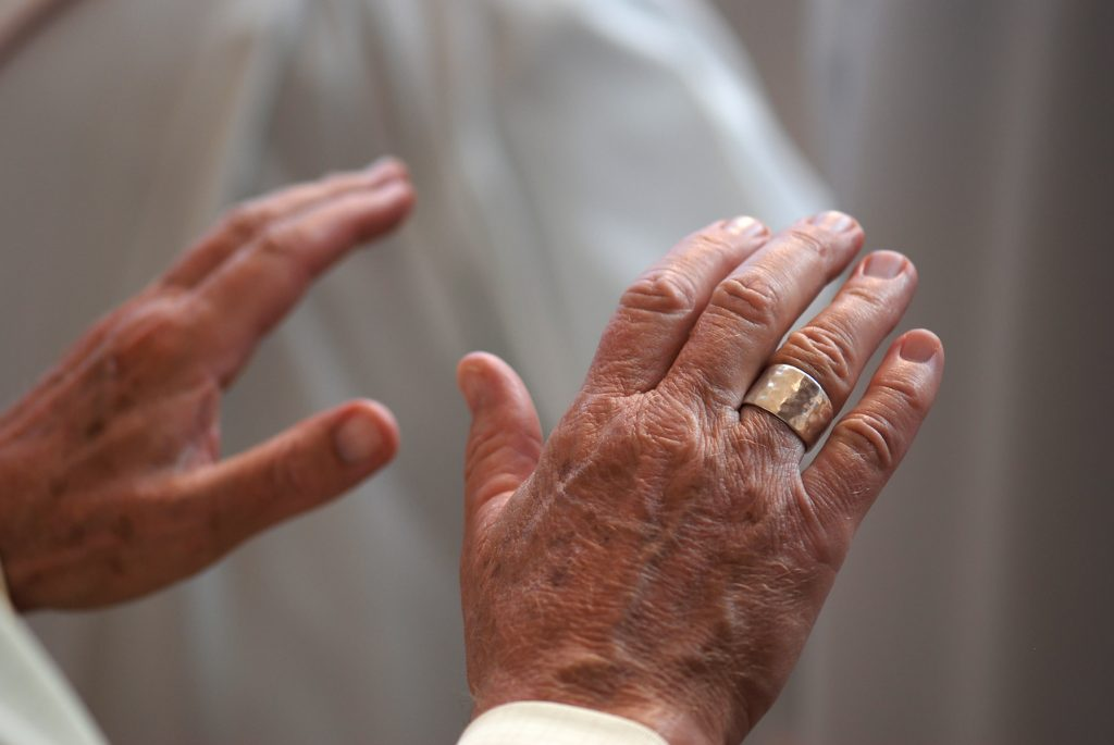 Hands of a Catholic priest, praying.
