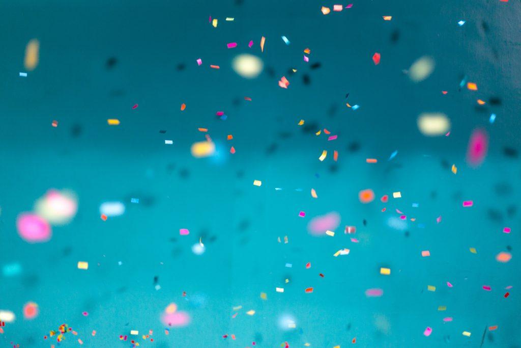 Confetti over blue background