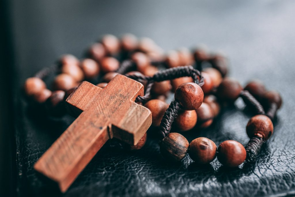 Wooden bead rosary on Bible